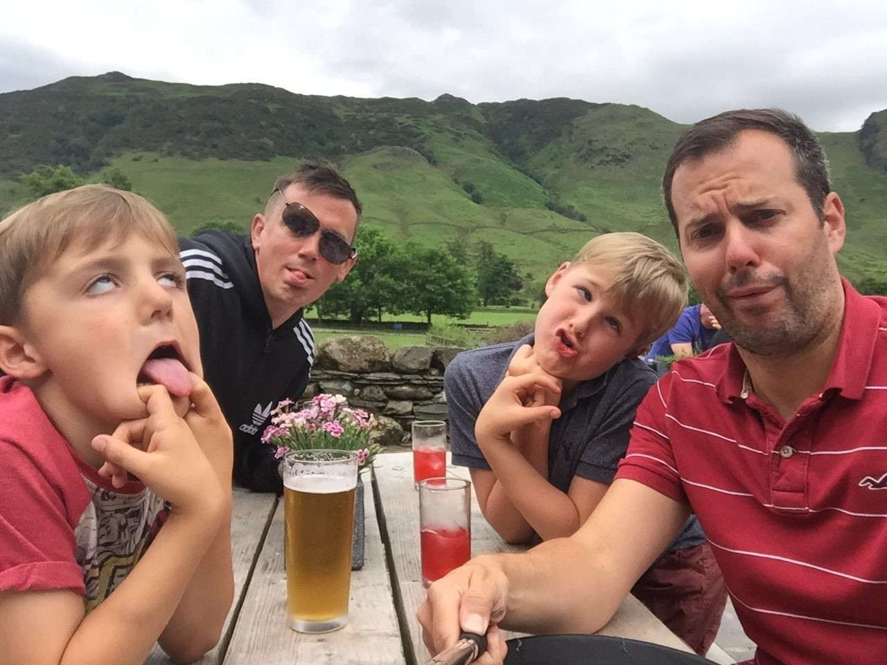 shared parental leave at REED - Peter Parking-Child with husband and boys pulling faces