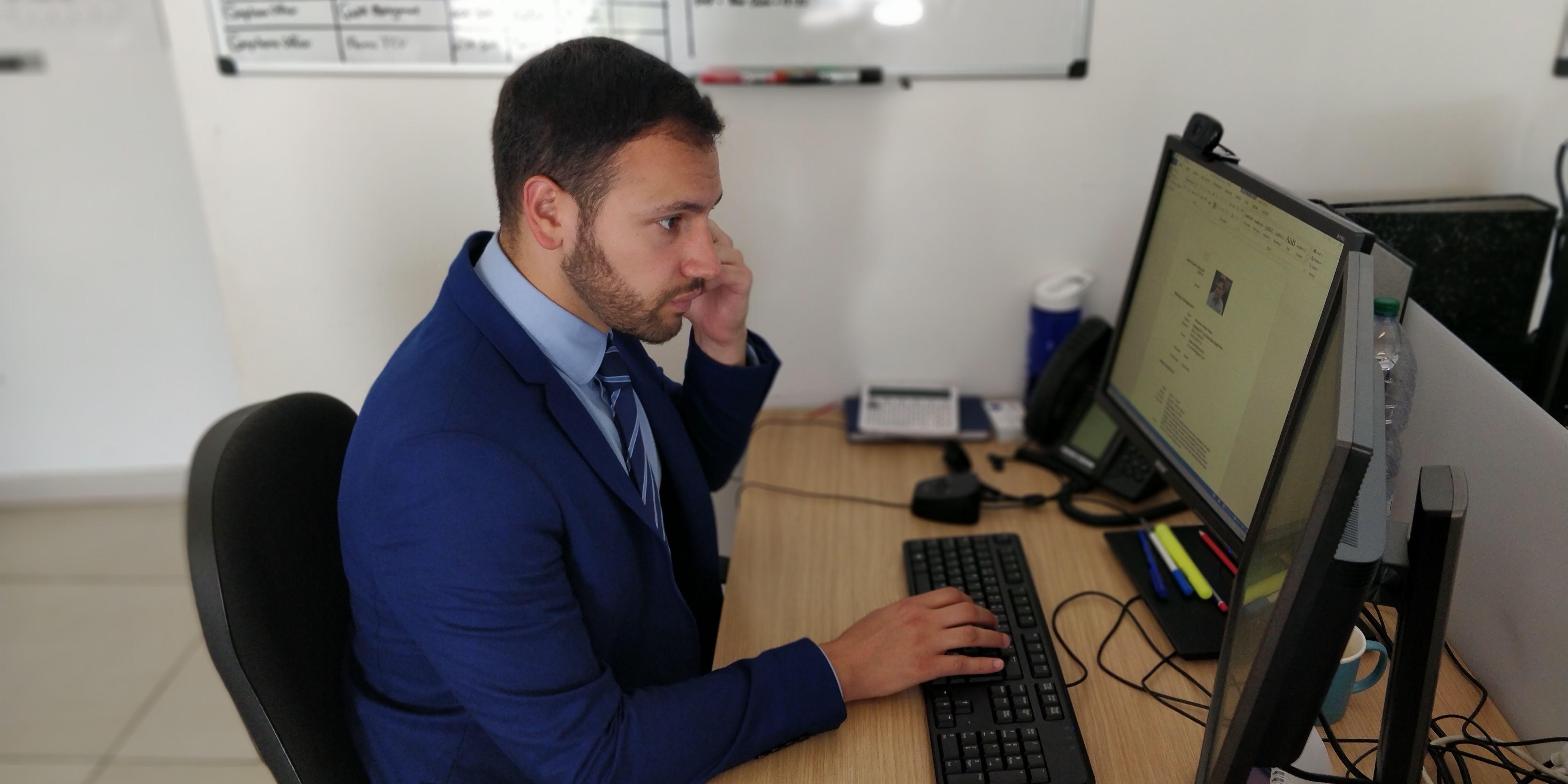 Malta office - male consultant at desk