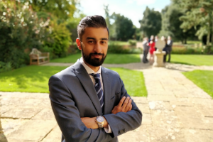 uk page - male consultant outside business school