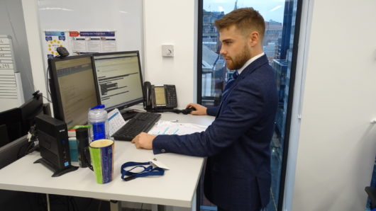 manchester office standing desk with male recruitment consultant