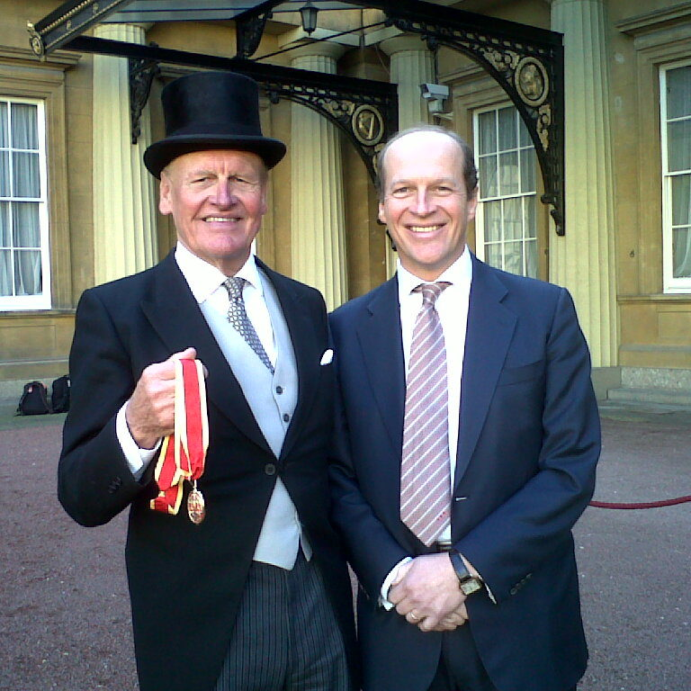 Sir Alec Reed with his medal, pictured with son James Reed